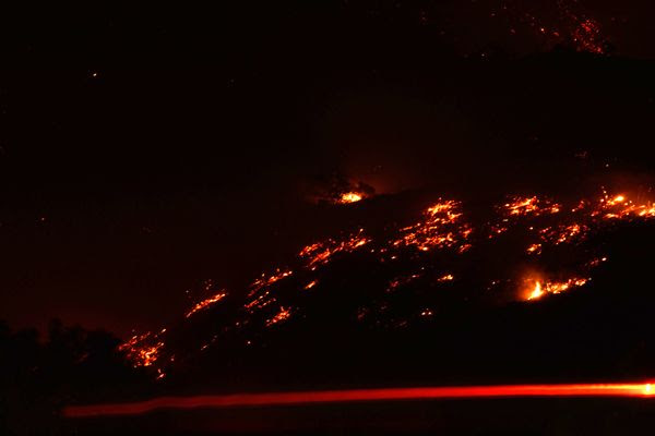 The Canyon Fire strikes a hillside in Corona, California...on September 25, 2017.