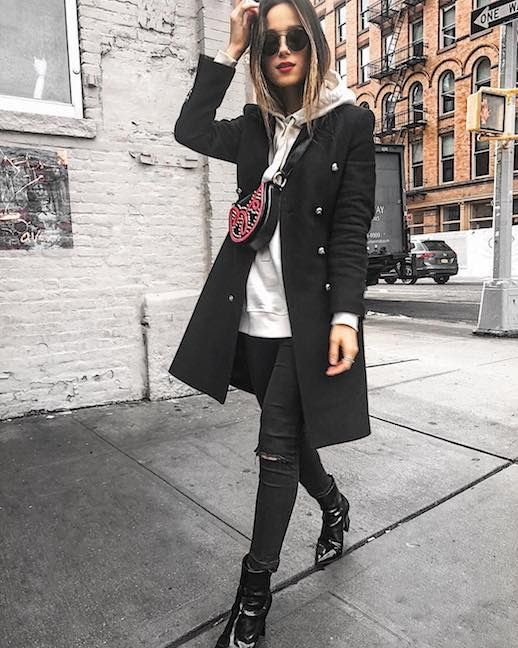 Le Fashion Blog Quick Casual Outfit Round Sunglasses Black Double Breasted Coat White Hooded Sweatshirt Black Distressed Skinny Jeans Black Patent Leather Boots Via @rutaenroute