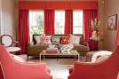 beige and red living room with coral red curtains and armchairs ...
