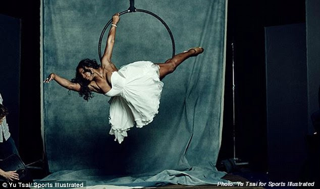 Flying high: The tennis star dons a flowy white dress as she strikes a graceful pose for the feature