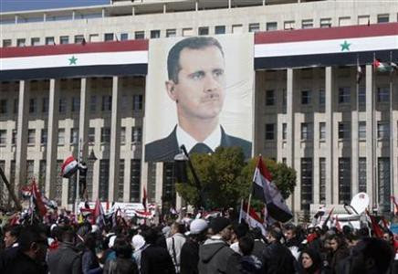 Thousands demonstrated in Syria on March 15, 2012 in support of the government of Bashar al-Assad. The gathering was designed to mark the first anniversary of the western-backed rebellion inside the country. by Pan-African News Wire File Photos