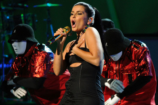 B.C. singer and songwriter Nelly Furtado will donate $1 million she received for performing for the family of Libyan leader Moammar Gadhafi.