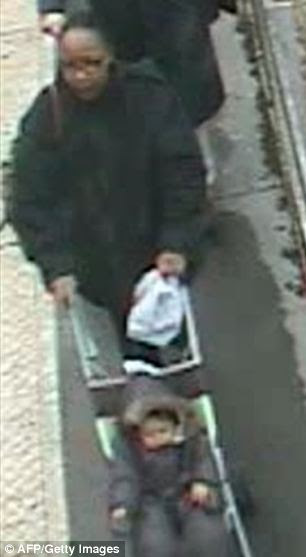 Horrific: A CCTV image has been released showing a woman pushing a pram in Berck sur Mer on November 19