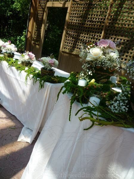 Enchanted forest themed head table & cake table.   Wedding