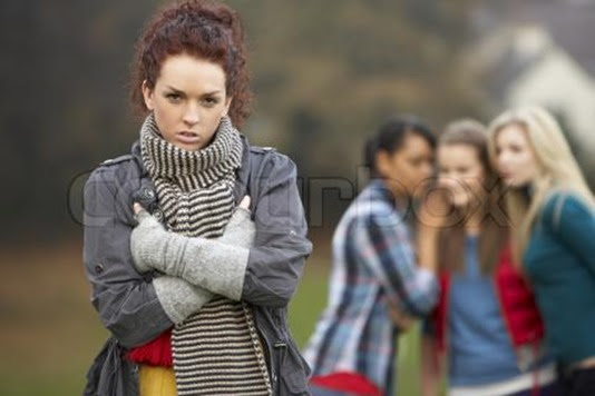 teenage-girl-with-friends-gossiping-in-background