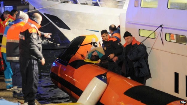 "Rescue operations evacuating some of passengers from the Norman Atlantic ferry on a ""Capitaneria di Porto"" patrol boat in the harbour of Otranto, Italy, 28 December 2014."