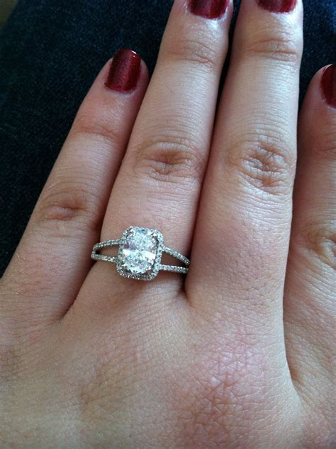 My 1 carat oval diamond engagement ring with a rectangle