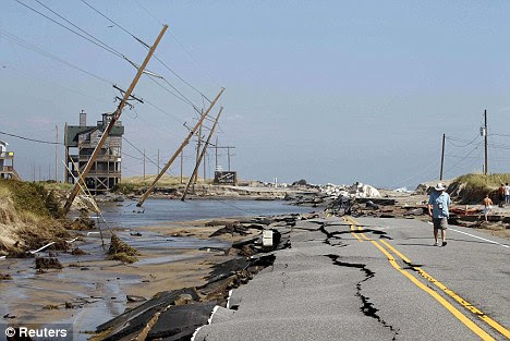 Highway 12, the main road that connects Cape Hatteras National Seashore to the mainland, after it was destroyed by Hurricane Irene in Rodanthe, North Carolina