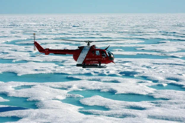 The ship's helicopter will often check to see what ice conditions are ahead of the Louis. An ice specialist can help gauge the thickness of ice by its color and shape.