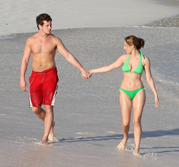 .Actress Kelly Brook and her boyfriend, rugby player Danny Cipriani, continue their romantic island getaway in the Caribbean by strolling on the beach hand-in-hand and embracing for some kissing.