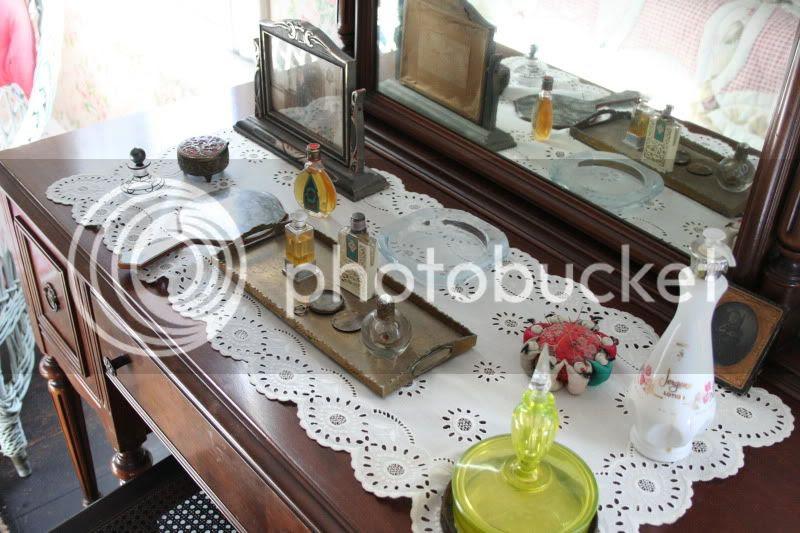 antique perfumes on vanity