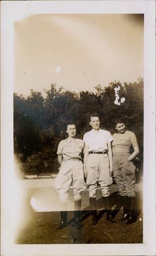 Two women and one man in jodhpurs