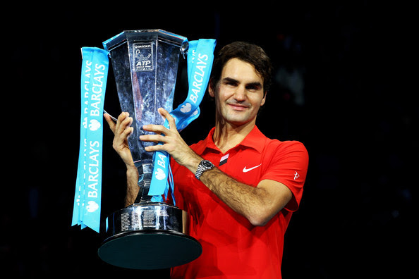 Roger Federer Roger Federer of Switzerland poses with the trophy after defeating Rafael Nadal of Spain in their men's final match during the ATP World Tour Finals at O2 Arena on November 28, 2010 in London, England.