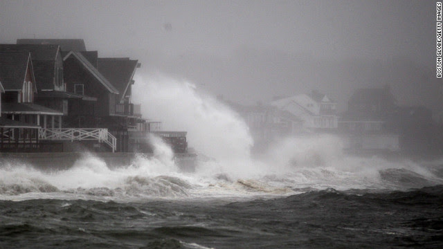 Waves slam into the sea wall in Scituate, Massachusetts, on Monday.