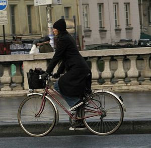 A woman on a bike in Paris.