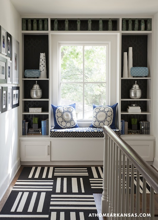 blue and white and black design decor stair case built in book shelves