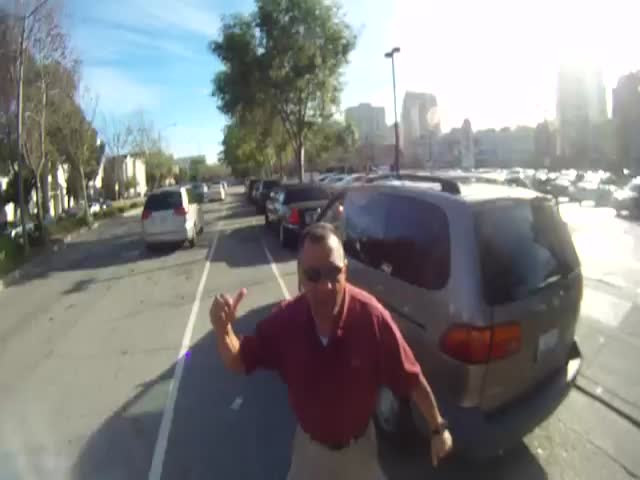 Car Driver Cuts Off Cyclist, Then Goes Full Road Rage