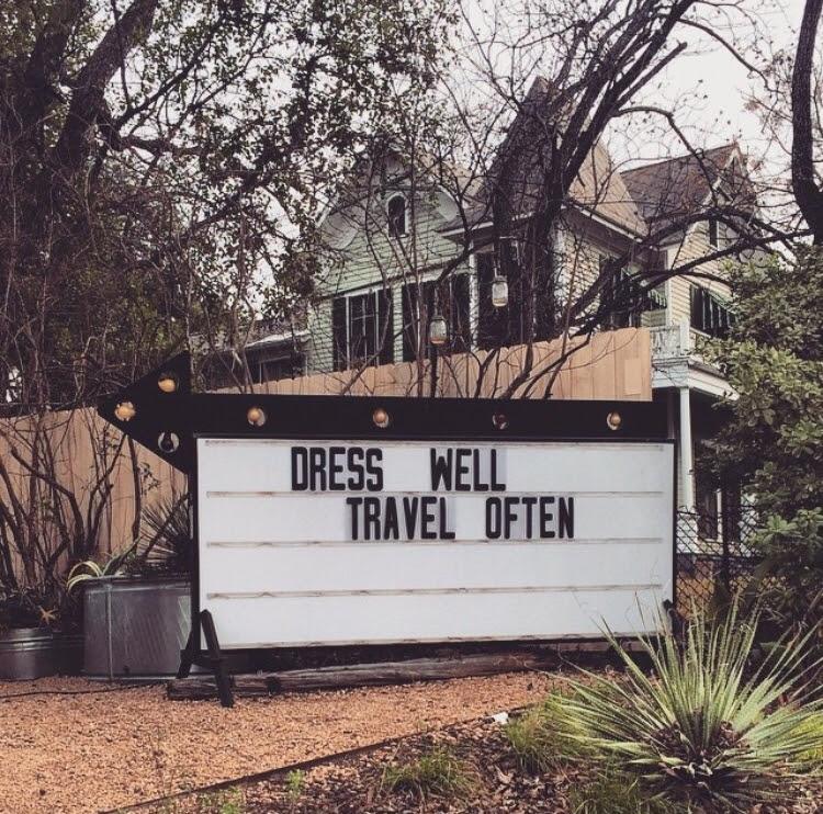Dress well travel often