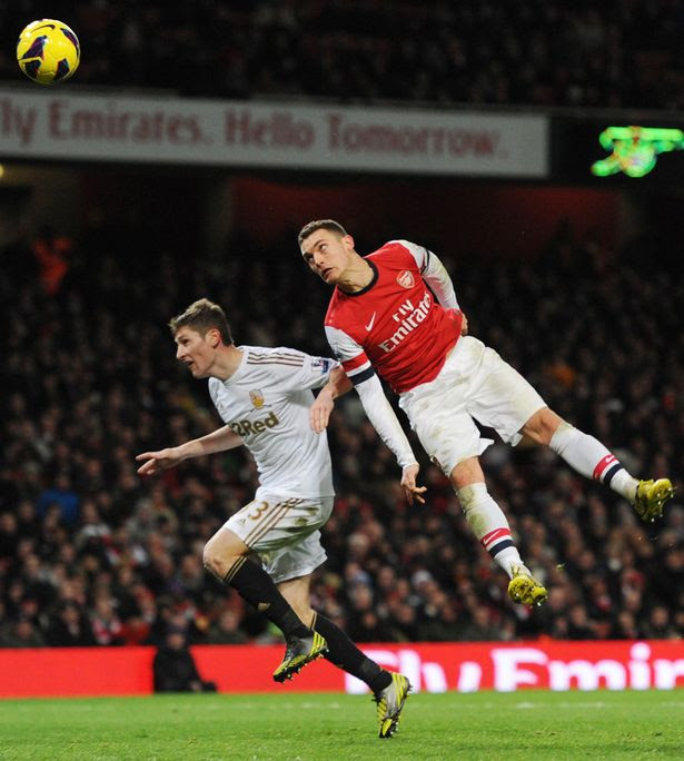 In the Bould mould: Arsenal's Thomas Vermaelen heads at goal