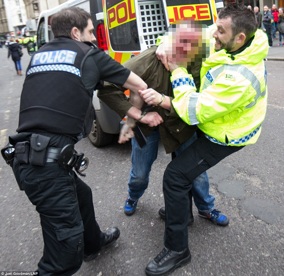 A man is wrestled to the ground as violent clashes take place in Newcastle city centre as an anti-Islam march is met by a counter protest