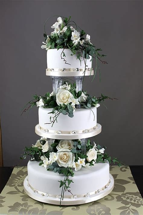 wedding cakes with separated tiers   and flowers in