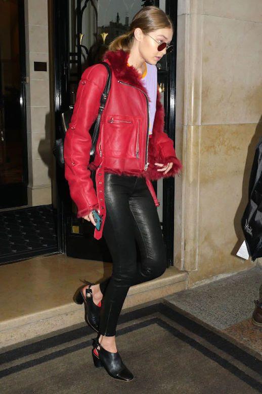 Le Fashion Blog Gigi Hadid Red Leather Jacket Purple Tee Leather Leggings Black Mule Heels Via Harpers Bazaar