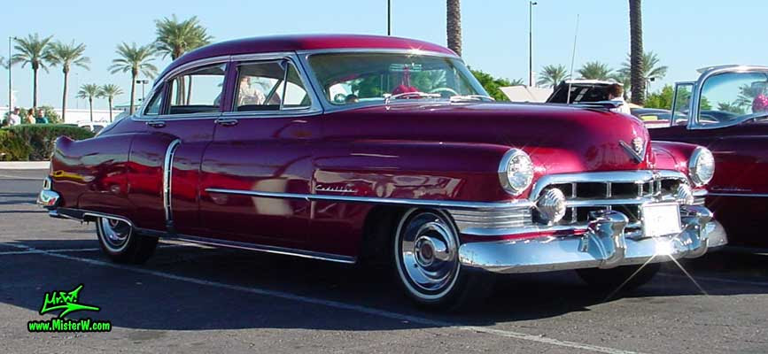 Photo of a cherry red 1950 Cadillac Series 62 4 door sedan at the Scottsdale Pavilions classic car show in Arizona. 1950 Cadillac 4 door sedan