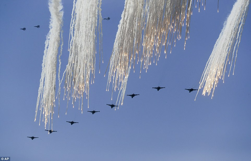 A group of Russian military jets fire flares during military drills at the Black Sea coast. Flares are used to protect aircraft from heat-seeking missiles by diverting them off course