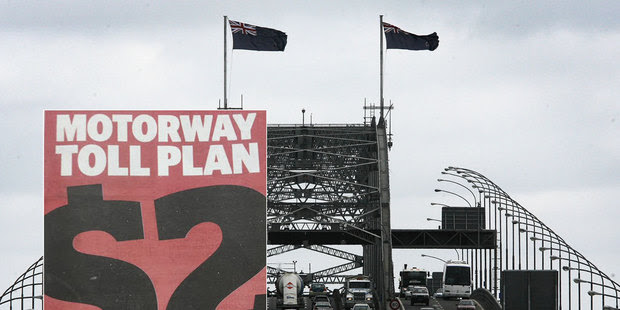 Drivers could pay an Auckland motorway toll of about $2 under a congestion-busting, road-building plan being unveiled today.