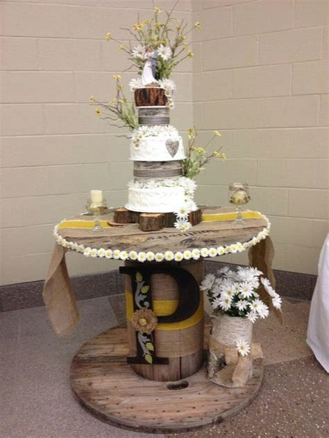 Rustic wedding cake with a custom wooden rustic cake stand