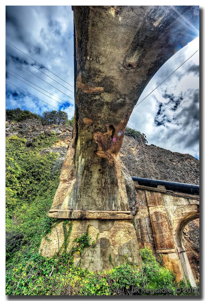 Decaying bridge by JR Regaldie Photo
