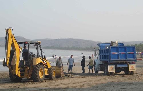 Sailboat loaded onto dump truck