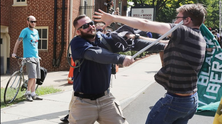 """White nationalists, neo-Nazis and members of the """"alt-right"""" clash with counter-protesters in the street after the """"Unite the Right"""" rally was delcared a unlawful gathering by Virginia State Police August 12, 2017 in Charlottesville, Virginia. After clashes with anti-fascist protesters and police the rally was declared an unlawful gathering and people were forced out of Lee Park, where a statue of Confederate General Robert E. Lee is slated to be removed."""