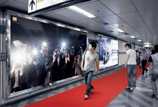 billboard of people taking pictures and flashes paparazzi