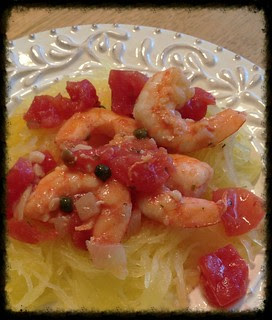 Shrimp with tomatoes over spaghetti squash