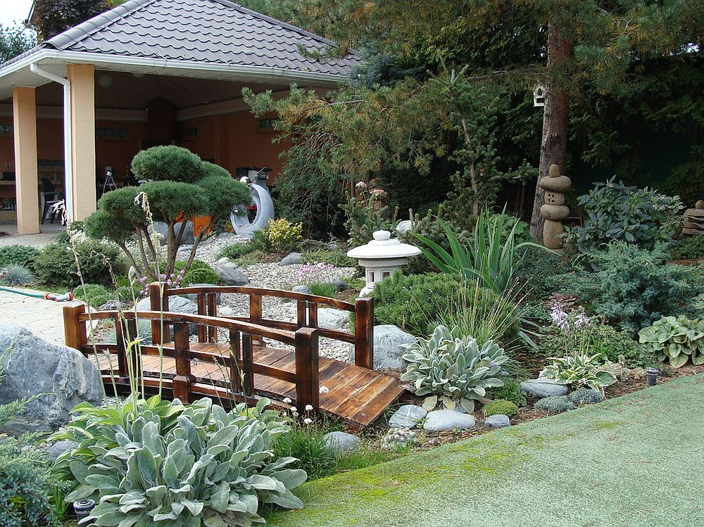Wooden bridge gives the Asian garden that timeless Japanese style and Oriental vibe