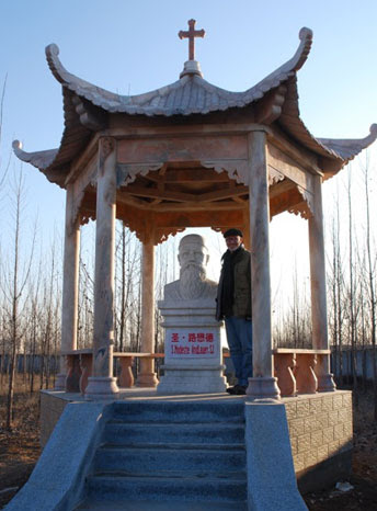 Anthony Clark and the new pavillion at Wuyi Village in honor of Saint Modeste Andlauer, SJ.