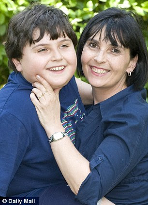 Bright as a button: Valentino Bocca age nine years, before teh MMR triple jab, with his mother Antonella. Valentino has Autism which a judge has ruled to have been provoked by the MMR vaccine