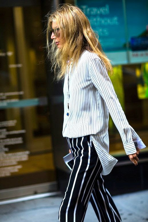 Le Fashion Blog Fall Street Style Nyfw Blonde Sunglasses Striped Button Down Shirt Black And White Pants Via The Cut