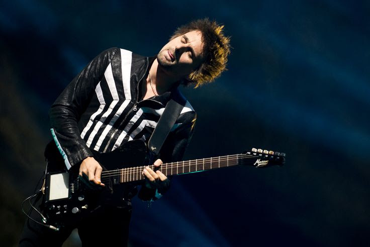 (Molly J. Smith   Special to The Salt Lake Tribune)   Lead singer and guitarist Matthew Bellamy of Muse performs at the Energy Solutions Arena in Salt Lake City on Sept. 20, 2013.
