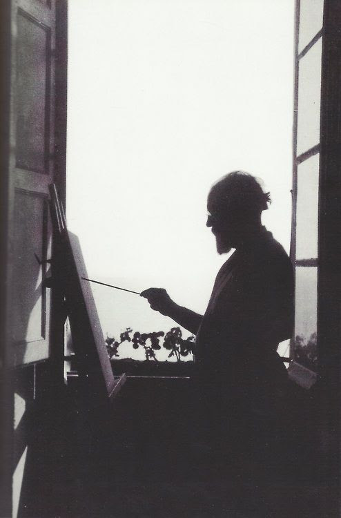 Henri Matisse painting in his apartment in Nice (c. 1910)