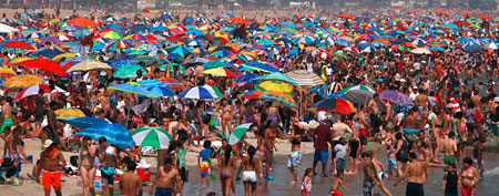 Crowds at the beach at Coney Island on June 30, 2012. (Eric Thayer/Reuters)