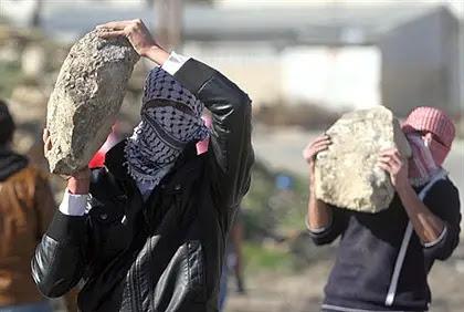Arab terrorists hurl rocks (file)