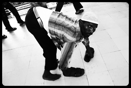 Four Legged Creature Called Man - Muslim Beggar On Eid 2010 by firoze shakir photographerno1