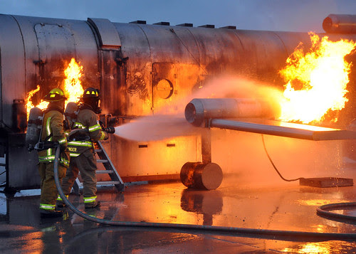 Firefighters train to extinguish an aircraft fire. by Official U.S. Navy Imagery