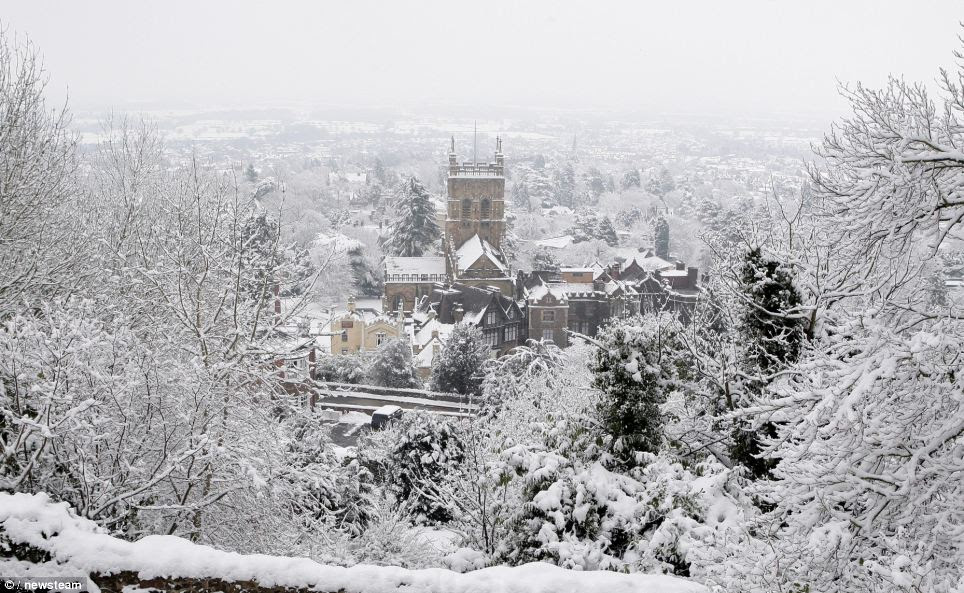 Malvern Abbey as seen from the Malvern Hills, Worcestershire, today as the latest snowfall has created some postcard perfect scenes around the country but has caused chaos elsewhere