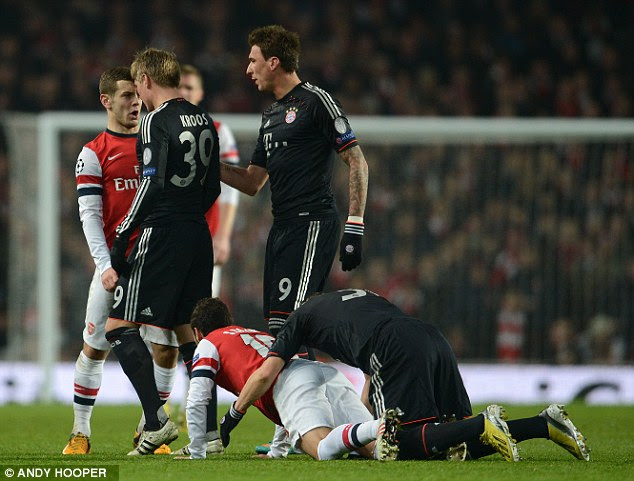 Fired up: Jack Wilshere gets involved in a confrontation with Kroos after a foul on Santi Cazorla