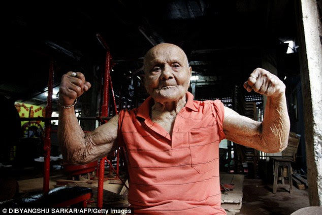 'Pocket Hercules': Former Mr Universe Manohar Aich flexes his muscles as he poses for a photograph on the eve of his 100th birthday in a gymnasium in Kolkata, India