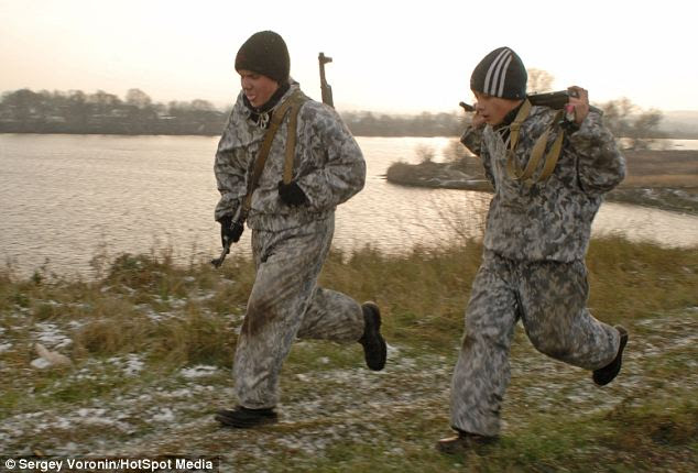 Fitness test: Every year camouflage clad children and adults from the club march into the mountains of the Crimea for an annual 130km trek
