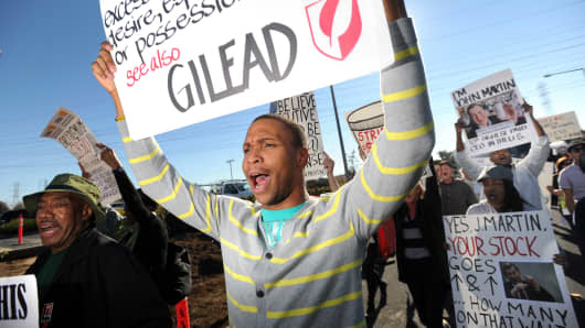 About 40 protesters from across the country converged on Gilead Sciences headquarters in Foster City, Calif., Nov. 14, 2012, calling on the drug maker to lower prices for its Stribild AIDS medication.